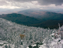 View south from the summit of Caribou Mountain, Caribou-Speckled Mountain Wilderness, White Mountain National Forest, Maine. October snowfall sugar-frosted the stock photo
