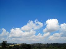 LANDSCAPE IN AFRICA UNDER BLUE SKY WITH CLOUDS Stock Image
