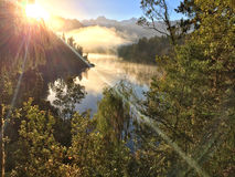 View of Southern Alps from lake Matheson in the early morning mi Stock Images