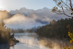 View of Southern Alps from lake Matheson in the early morning mi Royalty Free Stock Photo
