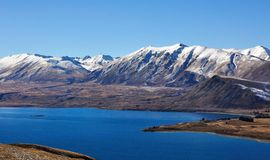 View of Southern Alps from Lake Tekapo. Mountain and lake view from mt.john, lake tekapo, south Island New Zealand royalty free stock photos
