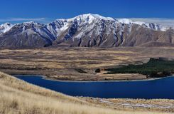 View of Southern Alps from Lake Tekapo. Southern Alps scenic view from mt john lake tekapo new zealand royalty free stock photo