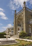 View of the southern facade of the Vorontsov Palace, decorated with sculptures of lions and a fountain, in Alupka. Crimea royalty free stock image