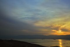 View on Dead Sea at Sunrise. A view at the southern part of the Dead Sea from the mountains to its east, at the time of a magical sunrise Stock Images