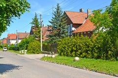 View of Sovetskaya Street in the summer afternoon. Settlement Amber, Kaliningrad region.  Stock Photo