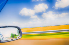 View from the speeding car. blurred landscape. slow shutter speed. Royalty Free Stock Photography