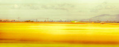 View from the speeding car. blurred landscape. slow shutter speed. Stock Image