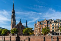View from the Speicherstadt to the main church St. Katharinen. royalty free stock images