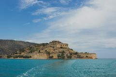 View on Spinalonga from boat. On the fortress. Turque sea can bee clearly seen royalty free stock photography