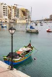 View of Spinola Bay at St. Julian`s, Malta with boats and buildings stock photo