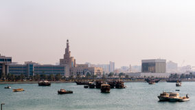 A view of spiral mosque (Fanar) from the beach. Doha coastline, dhow and indian ocean Royalty Free Stock Photos