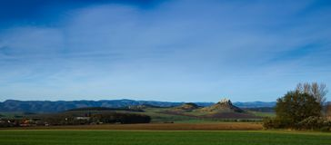 A northern panoramic view of Spis castle, Drevenik, Ostra hora and Slovak Ore Mountains in early spring with power lines removed f. A view of Spis castle, Ostra royalty free stock photography
