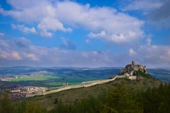View of the Spis castle and Spisske podhradie from the south in the morning in early spring with cloudy sky. Windy cloudy weather in the Spis region of Slovakia stock image