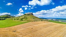 View of Spissky hrad and a field with round bales in Slovakia. Central Europe stock photography