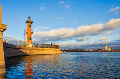 The view of The Spit of Vasilievsky island and the Rostral column. Royalty Free Stock Photo