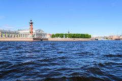 View of the spit of Vasilievsky island and rostralnie columns. St. Petersburg view on Neva river. View of the spit of Vasilievsky island and rostralnie columns Stock Images