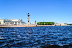 View of the spit of Vasilievsky island and rostralnie columns. St. Petersburg view on Neva river. View of the spit of Vasilievsky island and rostralnie columns Royalty Free Stock Photo