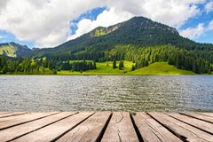 Idyllic lake in the mountains - Spitzingsee. View on the Spitzingsee in Bavaria, Germany royalty free stock photos