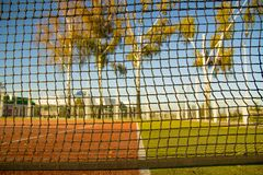 View of the sports ground through the net stock photo