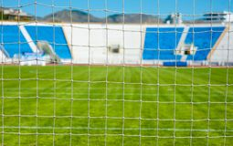 View of the sports stadium through the net of the football goal Royalty Free Stock Photo