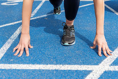 View of sportswoman on starting line at running track stadium Royalty Free Stock Photo