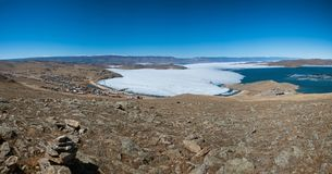 View of spring landscape in Siberia with part of frozen lake Baikal in the distance from the top view. Panoramic view of spring landscape in Siberia with part royalty free stock photos