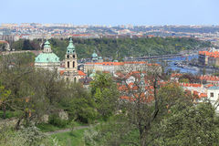 View on the spring Prague St. Nicholas' Cathedral with the green Nature and flowering Trees, Czech Republic Royalty Free Stock Photography