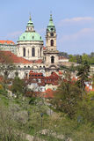 View on the spring Prague St. Nicholas' Cathedral, green Nature and flowering Trees, Czech Republic Royalty Free Stock Photos