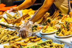 Spring rolls on street food market in Thailand. View on spring rolls on street food market in Thailand royalty free stock photo