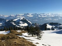 A view of the spring snow cover in the Swiss Alps from the Rigi Mountain. Canton of Lucerne, Switzerland Kanton Luzern, Schweiz royalty free stock images