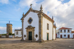 View at the square with Chapel and Tower clock in Rates ,Portugal Stock Images