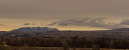 View of Squaw Butte from Boise Idaho. Durring winter. Broken Clouds and grey sky Stock Photo
