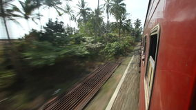 View of Sri Lankan countryside landscape from a moving train. stock footage