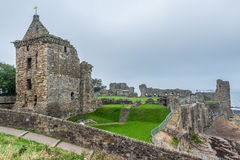 View of St. Andrews Castle main building and grounds. St. Andrews, Scotland - September 16, 2014: Three quarter view of ruinous St. Andrews Castle Fore Tower and Stock Images
