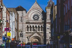 View of St Anne`s Church in DUblin city centre with pubs and res. DUBLIN, IRELAND - April 14th, 2018: 2018: view of St Anne`s Church in DUblin city centre with Stock Photos