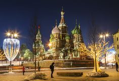 View of St. Basil`s Cathedral and the Kremlin in new year`s evening. Moscow royalty free stock photo