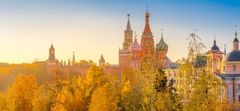 View of St. Basil`s Cathedral and Spassky Tower on Red Square at bright sunset, autumn evening. In Moscow stock photography