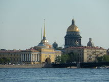 View of St. Isaacs Cathedral and the Neva river embankment. Saint-Petersburg. Russia. St. Isaacs Cathedral on the embankment of the river Neva in St. Petersburg Stock Photo