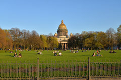 View of St. Isaac's Cathedral, Senate square and tourists on the Royalty Free Stock Photo