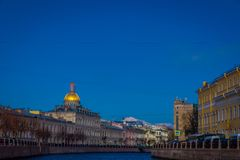 View of the St. Isaac`s Cathedral, the surrounding streets, waterfront canal and houses. In St. Petersburg Russia Royalty Free Stock Photos