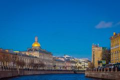 View of the St. Isaac`s Cathedral, the surrounding streets, waterfront canal and houses. In St. Petersburg Russia Stock Image
