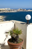View of st. julians from sliema malta. View of limestone beach mediterranean sea coastline and paceville st. julians hotels condominiums development from sliema Royalty Free Stock Photos