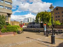 St. Katharine Docks - a quarter and marina next to the Tower of London and Tower Bridge on a sunny day. royalty free stock photo