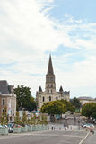 View of St Laud's Church in Angers, France. ANGERS, FRANCE - JULY 28, 2014: view of Place du President Kennedy, Place de L'Academie and St Laud's Church in Stock Images