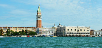 View of St Mark`s bell tower and the Doge`s Palace taken from vaporetto on the Venice Lagoon, Italy Royalty Free Stock Image