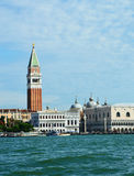 View of St Mark`s bell tower and the Doge`s Palace taken from vaporetto on the Venice Lagoon, Italy Stock Image