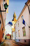 View of St.Mary Church and street with Estonian flags. Tallinn. Stock Photo