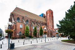 View of St Mary Magdalene Church in Wroclaw city. Travel to Poland - view of St Mary Magdalene Church from Wita Stwosza street in Wroclaw city in autumn royalty free stock image