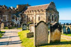 View of St Mary's Church, gravestones and Whitby Abbey in North Yorkshire, UK Royalty Free Stock Images