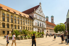 View of the St. Michael's Church and the pedestrian street of Neuhauser in centre of Munich. Bavaria. MUNICH, GERMANY - JUNE 7, 2016: View of the St. Michael's Stock Image
